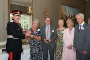 Long serving volunteers accept the Queen's Award from the Lord Lieutenant